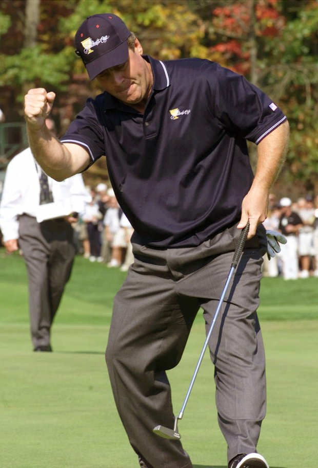 U.S. Team member Hal Sutton throws a fist as he sinks a birdie putt on the first hole during a four ball match with against the International team of Greg Norman of Australia and Michael Campbell of New Zealand at the President's Cup golf tournament at the Robert Trent Jones Golf Club in Gainesville, Va., Saturday, Oct. 21, 2000. Sutton was paired with U.S. teammate Jim Furyk.
