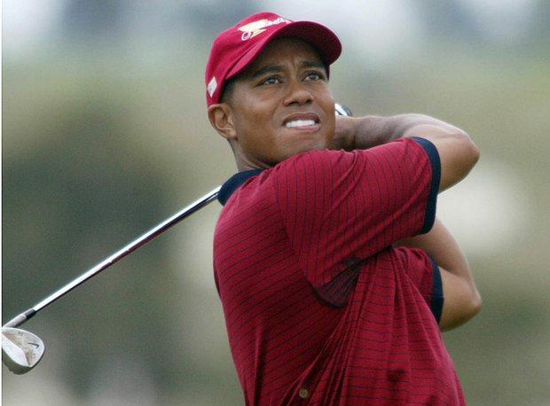 Tiger Woods plays his second shot to the 3rd hole during his singles match against International Team's Ernie Els of South Africa on the last day of the Presidents Cup 2003 Golf Tournament at Fancourt Golf Estate in George, South Africa, Sunday, Nov. 23, 2003
