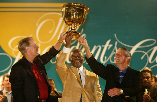 South African president Thabo Mbeki, center, presents the Presidents Cup to the two sharing captains: United States' Jack Nicklaus, left, and International Team's Gary Player, right at the closing ceremony at Fancourt, George South Africa, in this Nov. 23, 2003 photo. There was a sudden death playoff between America's Tiger Woods and International Team's Ernie Els, of South Africa, but the tournament was declared a tie as darkness fell.