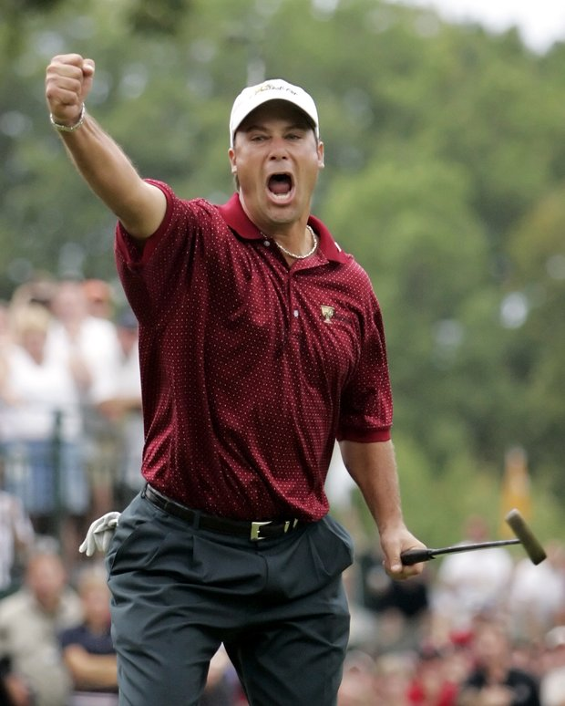 Chris DiMarco, of the United States, celebrates after dropping his birdie putt on the 18th hole to beat Stuart Appleby, of Australia, 1-up, and give the U.S. the Presidents Cup, 18-15, in this Sept. 25, 2005 file photo, at the Robert Trent Jones Golf Club in Gainesville, Va.