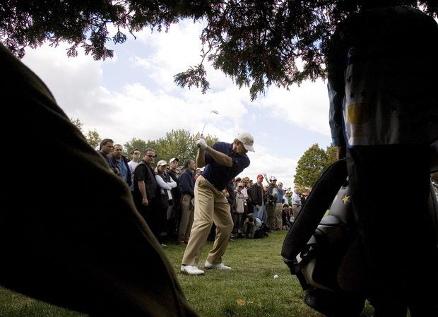 International team member Retief Goosen, of South Africa, takes a shot off the fairway on the first hole during fourth round four-ball matches of the Presidents Cup Golf Tournament at the Royal Montreal Golf Club in Montreal, Canada, Saturday Sept. 29, 2007.