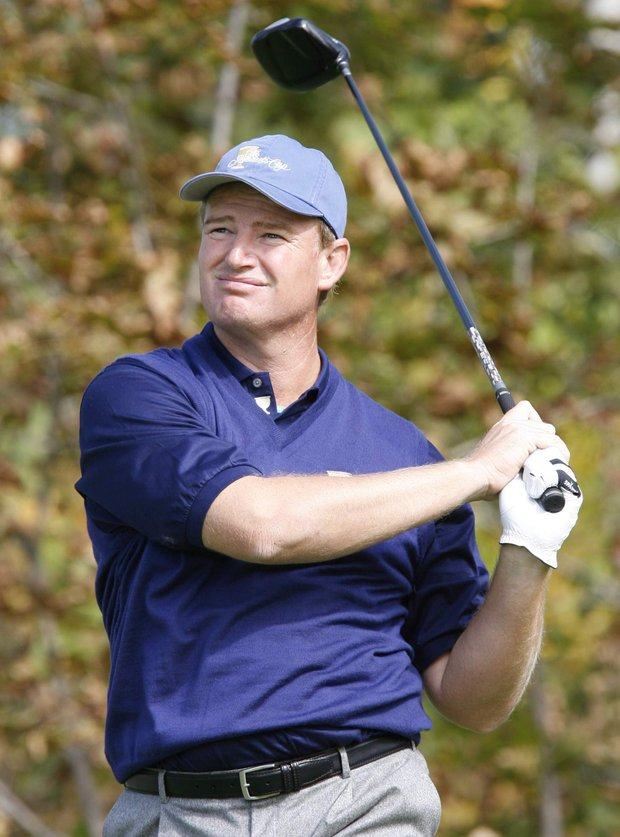 International team member Ernie Els watches his drive during his singles match against Lucas Glover at the Presidents Cup golf tournament at the Royal Montreal Golf Club in Montreal Sunday, Sept. 30, 2007