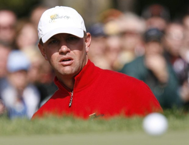 United States team member Lucas Glover watches the ball roll onto the green after a chip shot on the fourth hole during his singles match against Ernie Els at the Presidents Cup Golf Tournament at the Royal Montreal Golf Club in Montreal, Canada, Sunday Sept. 30, 2007.