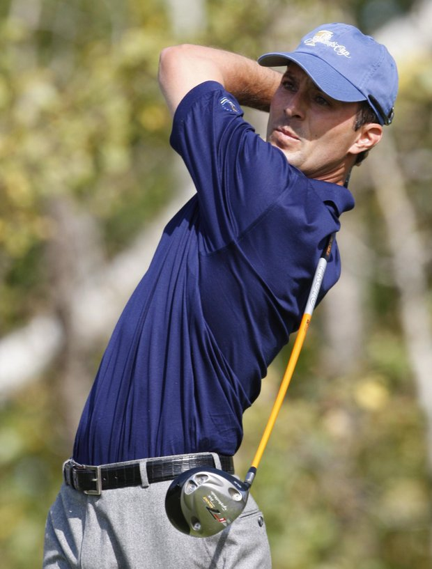 International team member Mike Weir watches his drive during his final singles match against Tiger Woods at the Presidents Cup golf tournament at the Royal Montreal Golf Club in Montreal, Sunday Sept. 30, 2007.