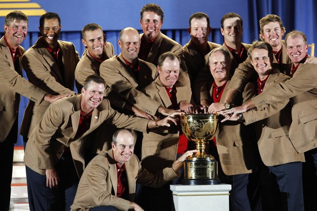 Members of the U.S. team pose with the Presidents Cup during the closing ceremonies after beating the International team by five points at Royal Montreal Golf Club in Montreal on Sunday, Sept. 30, 2007.