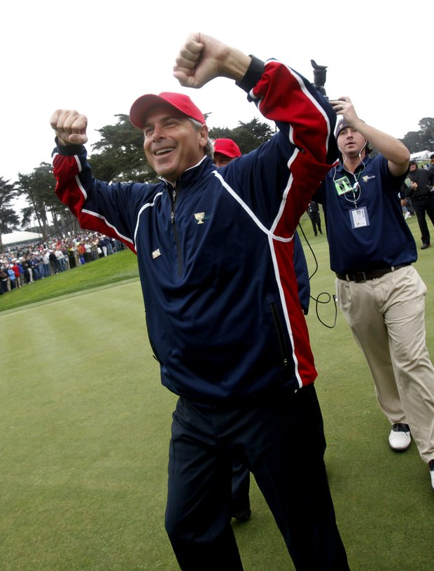 United States captain Fred Couples celebrates after U.S. team player Tiger Woods won his singles match to retain the Presidents Cup at Harding Park Golf Course Sunday, Oct. 11, 2009, in San Francisco.