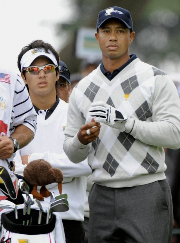 Japanese teenager Ryo Ishikawa (L) and Tiger Woods are photographed on the third day of the Presidents Cup at Harding Park Golf Course in San Francisco on Oct. 10, 2009.