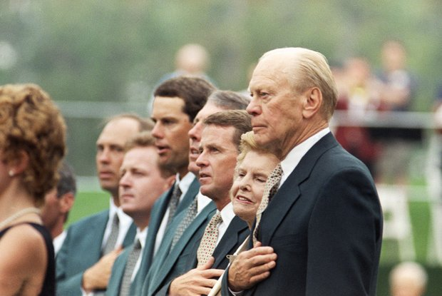 Former President Gerald Ford and his wife Betty, second from right, join the President Cup team members, from left, Tom Lehman, Jeff Maggert, Paul Azinger, Hale Irwin and tour director Tim Finchen during opening ceremonies of the inaugural event at the Robert Trent golf club in Gainesville, Va., Thursday, Sept. 15, 1994.