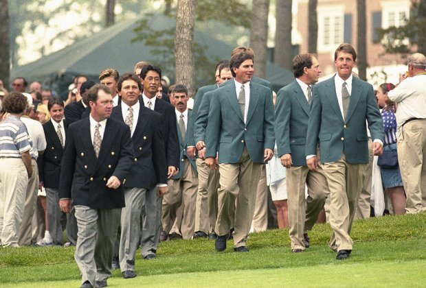 Presidents Cup American, right and International, left, team members walk together here to the opening ceremony for the inaugural event at the Robert Trent Jones Golf Club in Gainesville, Va, Sept. 15 1994.