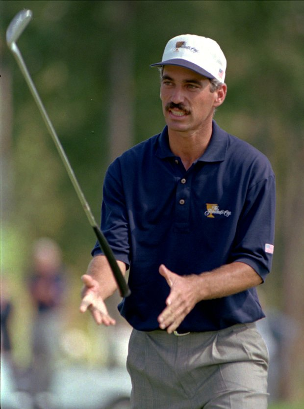 Presidents Cup American team member Corey Pavin, of Orlando, Fla., tosses his putter in the air after missing a birdie putt on the 10th green during the first round of the event at the Robert Trent Jones Golf Club in Gainesville, Va., on Friday Sept. 13, 1996.