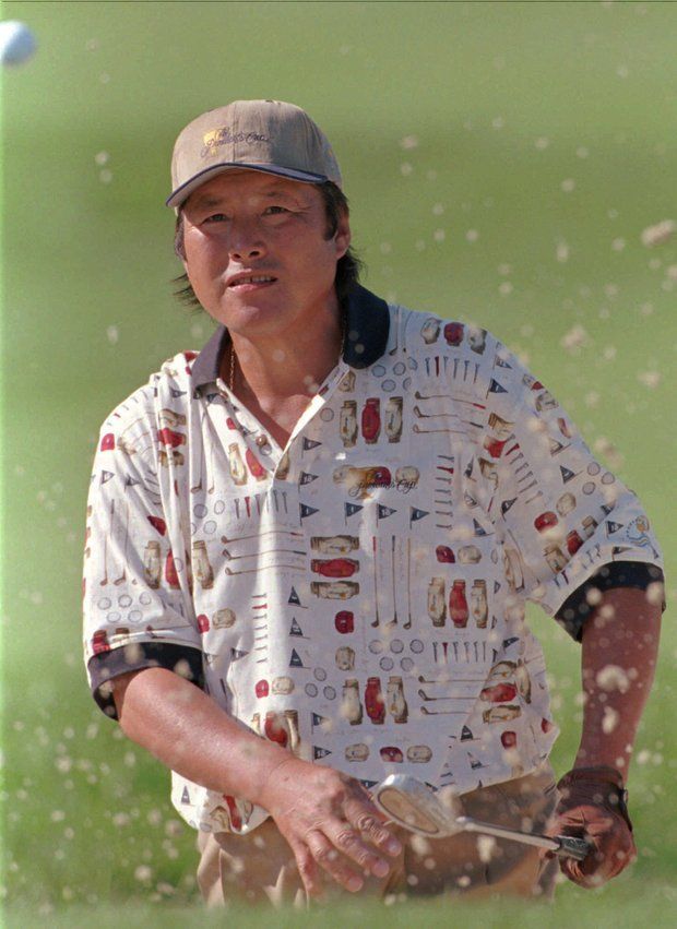 Japan's Jumbo Ozaki watches the ball after hitting out of a sand trap on the fifth hole during third round play of the Presidents Cup golf tournament at the Robert Trent Jones Golf Club in Gainesville, Va., Saturday, Sept. 14, 1996