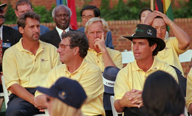 Members of the President's Cup International team, from left, Frank Nobilo, team captain Peter Thomson, Greg Norman, co-captain Ian Baker-Finch and Jumbo Ozaki watch the proceedings at the awards ceremony at the Robert Trent Jones Golf Club in Gainesville, Va. Sunday Sept. 15, 1996. The team lost the Cup on the 17th hole when Fred Couples sank a long birdie putt.