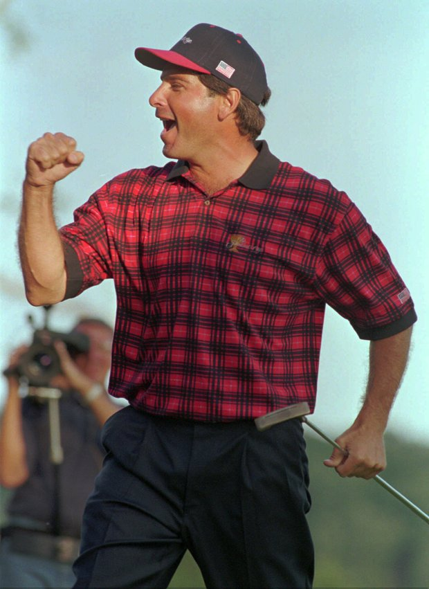 United States team member Fred Couples pumps his fist after winning the 17th hole, and his match, against International team member Vijay Singh in the Presidents Cup Sunday, Sept. 15, 1996 at the Robert Trent Jones Golf Club in Gainesville, Va. His match victory gave the United States a 16 1/2-15 1/2 victory over the International team to retain the trophy in the second edition of the biennial competition.