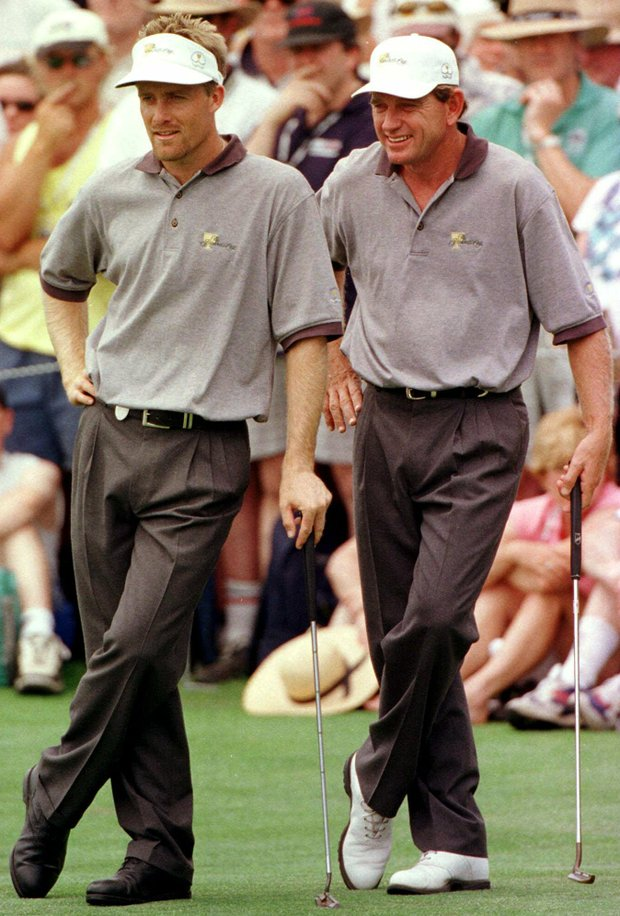 International Presidents Cup golfers Stuart Appleby of Australia, left, and his partner Nick Price of Zimbabwe watch as their American opponents David Duval and Phil Mickelson miss a putt to give the International team a 1 up victory during the second day morning foursomes at Royal Melbourne Golf Course, Australia Saturday, Dec. 12, 1998.