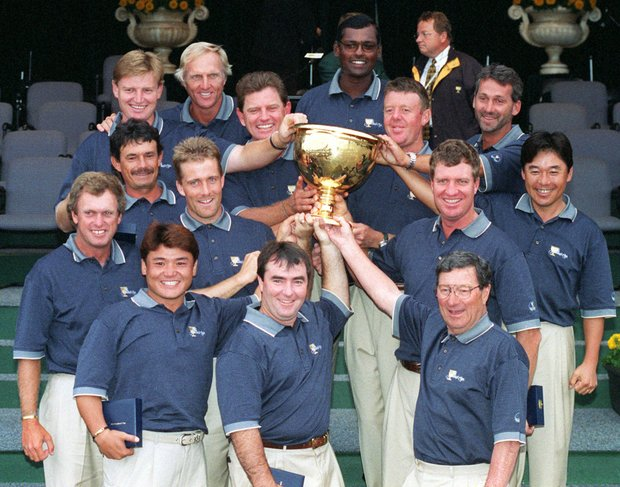 The International team poses with the Presidents Cup after defeating the United States in this Dec. 13, 1998 photo in Melbourne, Australia.