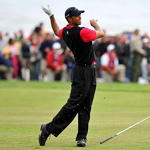 Tiger Woods drops his club as he hits a shot on the 14th hole during the fourth round of the 110th U.S. Open golf tournament at the Pebble Beach Golf Links in Pebble Beach, California, USA on Sunday, June 20, 2010.
