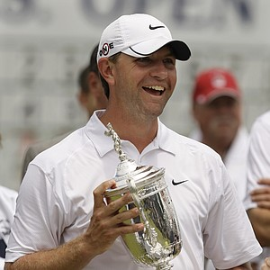 Lucas Glover holds his trophy after winning the U.S. Open Golf Championship at Bethpage State Park's Black Course in Farmingdale, N.Y., Monday, June 22, 2009.