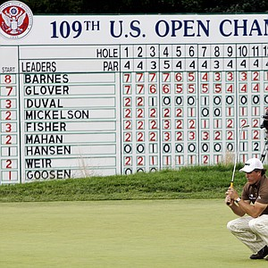 Phil Mickelson reacts after missing a putt on the 18th green during the final round of the U.S. Open Golf Championship at Bethpage State Park's Black Course in Farmingdale, N.Y., Monday, June 22, 2009.