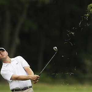 Lucas Glover watches his shot out of the rough off the ninth fairway during the final round of the U.S. Open Golf Championship at Bethpage State Park's Black Course in Farmingdale, N.Y., Monday, June 22, 2009.