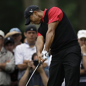 Tiger Woods drives from the 12th tee box during the final round of the U.S. Open Golf Championship at Bethpage State Park's Black Course in Farmingdale, N.Y., Monday, June 22, 2009.