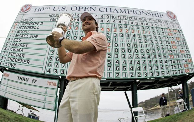 Graeme McDowell of Northern Ireland holds up the U.S. Open trophy after winning the golf tournament Sunday, June 20, 2010, at the Pebble Beach Golf Links in Pebble Beach, Calif.