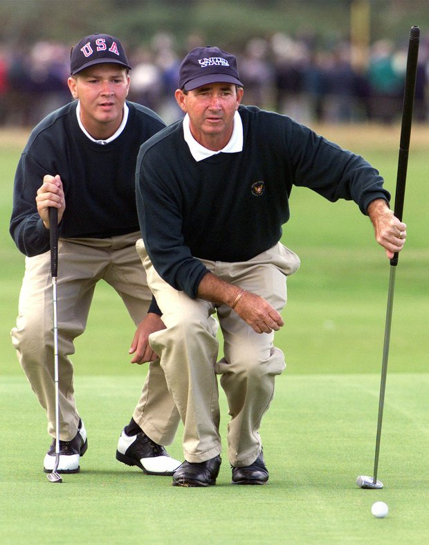 U.S. pairing Hunter Haas, left, and John Miller consult over the line of a putt at 17th hole during the foursome round of the Walker Cup at Nairn Golf Club in Scotland Sunday September 12 1999. The Walker Cup is a biennial amateur golf competition between The United States and a Great Britain and Ireland team. The competition is drawn 8-8 at the start of the fourth round.