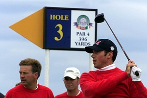 Matt Kuchar from Lake Mary, Fla., tees off at the third watched by U.S. Walker Cup teammates Tom McKnight, left, and Edward Loar during final practice for the Walker Cup in Nairn, Scotland, Friday, September 10, 1999. The Walker Cup is a biennial amateur golf competition between The United States and a Great Britain and Ireland team. Competition starts Saturday Sept. 11.