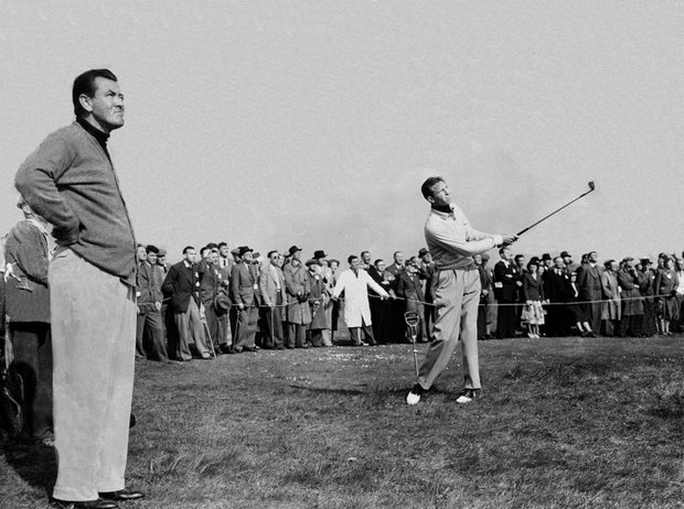 Golfer Charlie Coe clears from the rough on his way to the 14th green during first day's play in the Walker Cup match at Birkdale Course near Liverpool, England, May 11, 1951. Teammate Jim McHale is shown at left.