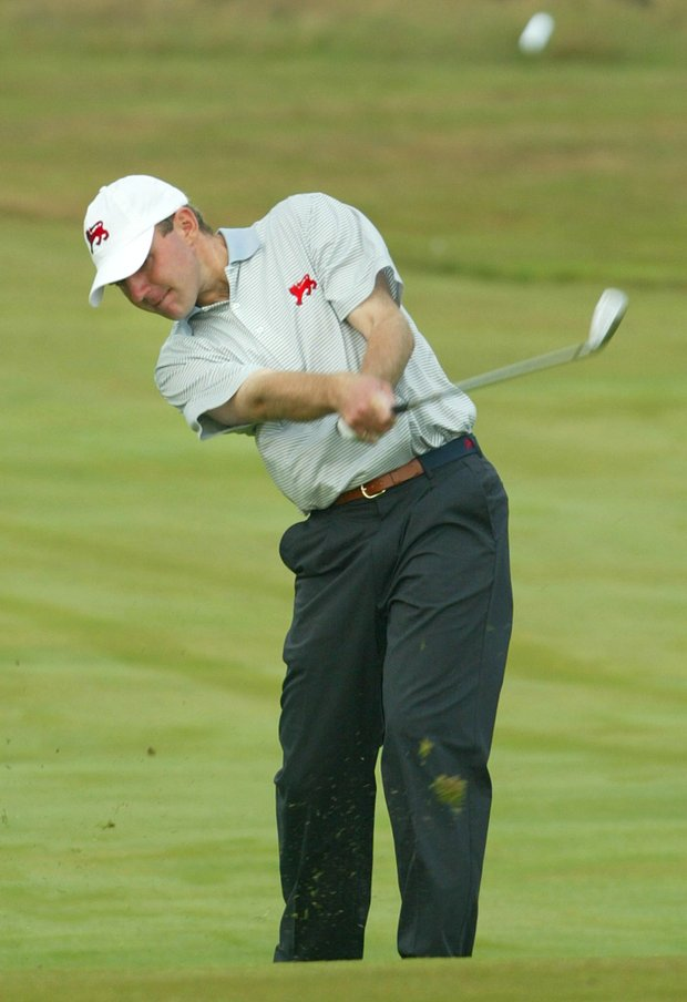 Britain and Ireland's Colm Moriarty fires in an iron shot to the 9th green in the opening foursomes matches, in the Walker Cup at Granton Golf Club in North Yorkshire England, Saturday Sept. 6, 2003. Moriarty was paired with Noel Fox against the United States pair of Adam Rubinson and Casey Wittenberg. Britain won the match 4 and 2.