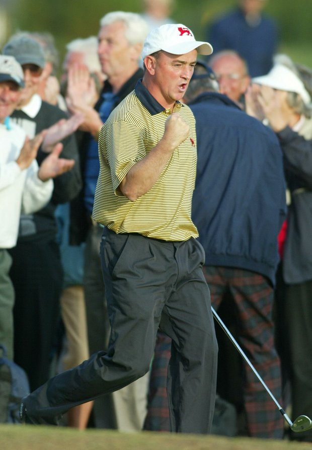 Nigel Edwards of the Britain and Ireland Walker Cup team walks onto the 14th green as he celebrates chipping in from off the green at the Ganton Golf Club in Northe Yorkshire, England, Sunday Sept. 7, 2003. Edwards was playing Lee Williams of the United States, their match ended all square. The Walker Cup is played by the top amateur golfers from Britain and Ireland against the United States. Britain and Ireland won the Walker Cup by 12 1/2 points to 11 1/2.