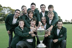 Members of the USA team pose with golf's Walker Cup during the trophy presentation Sunday, Sept. 13, 2009, at Merion Golf Club in Ardmore, Pa. USA defeated Great Britain and Ireland team for their third straight title.