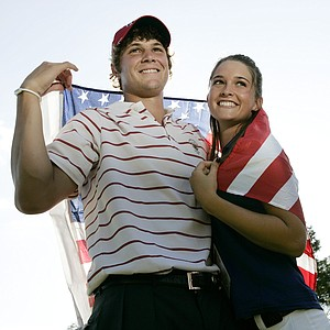Peter Uihlein of Orlando, Fla. is wrapped in an American Flag as he stands with Alessia Knight of Italy after he won his match 3 and 1 during a pairs round of golf's Walker Cup Sunday, Sept. 13, 2009, at Merion Golf Club in Ardmore, Pa.