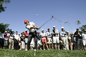 Rickie Fowler of Murrieta, Calif. hits from the rough on the fifth hole during a pairs round of golf's Walker Cup Sunday, Sept. 13, 2009, at Merion Golf Club in Ardmore, Pa.