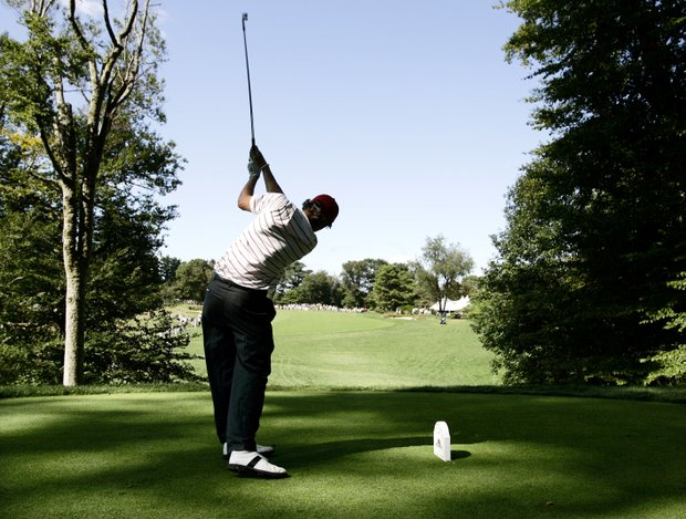 Peter Uihlein of Orlando, Fla. hits from the ninth tee during a pairs round of golf's Walker Cup Sunday, Sept. 13, 2009, at Merion Golf Club in Ardmore, Pa.