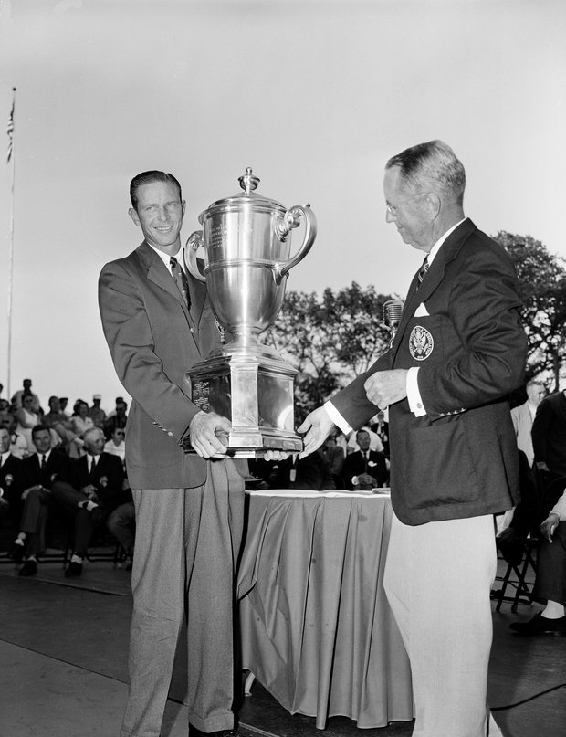 Golfer Charlie Coe, left, captain of the U.S. team, receives the Walker Cup after the championship golf matches with Britain's team wound up in Minneapolis, Aug. 31, 1957. Handing the cup to Coe is Richard S. Tufts, president of the U.S. Golf Association.