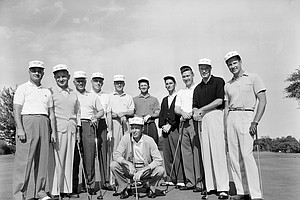 The American Walker Cup team gather on the putting green of Minikahda Club before playing practice rounds, Aug. 27, 1957, in Minneapolis. From left to right: Arnold Blum, Charles Kocsis, Joe Campbell, Frank Taylor, Jr., Billy Joe Patton, Mason Rudolph, Hillman Robbins, Jr., Rex Baxter, Bill Hyndman, and Bill Campbell. Team captain Charlie Coe squats front and center.
