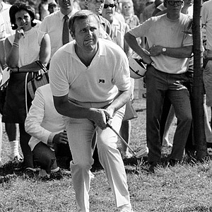 English Walker Cup team captain Mike Bonallack chews his tongue as he watches his shot from under trees in rough fly toward 14th hole at Milwaukee, Wis., Aug. 23, 1969. Americans won the tourney, 10-8.