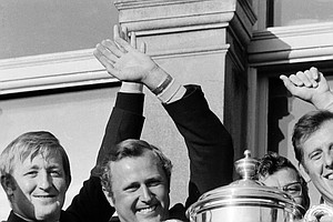 British Walker Cup team captain Mike Bonallack holds up the Walker Cup after the British team beat the U.S. in the Amateur golf Competition for the first time in 33 years, May 27, 1971, in St. Andrew, Scotland. Others are unidentified.