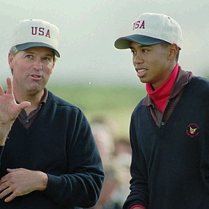 Tiger Woods, 19, right, of the United States and his partner John Harris, 43, talk over a difficult putt at the Royal Porthcawl Golf Club in Wales, western Britain Saturday September 9, 1995 during the First round in the Amateur Golf Walker Cup between the United States and Britain. They won their first match
