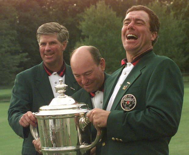 Team captain for the United States A. Downing Gray, center, celebrates after the U.S. defeated Great Britain/Ireland 18-6 to win amateur golf's Walker Cup Sunday, Aug. 10, 1997, at the Quaker Ridge Golf Club in Scarsdale, N.Y. Joining Gray are players John Harris, left, whose win gave the U.S. the deciding point and Jerry Courville.