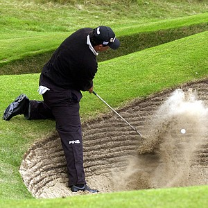Angel Cabrera of Argentina plays from a bunker on the 7th hole during the 1st round of the British Open Golf Championship at Royal Lytham and St. Annes golf course in England Thursday July 19, 2001.