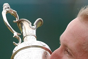 David Duval kisses the claret jug after winning the British Open Golf Championship at Royal Lytham and St. Anne's golf course in England in this July 22, 2001 photo.