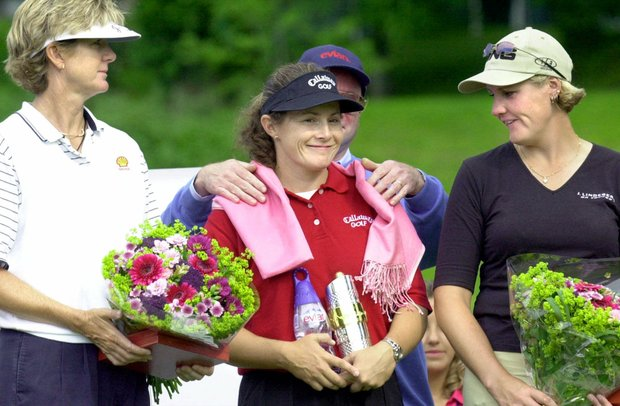 American Beth Daniel, left, Australia's Rachel Teske, center, and Sweden's Maria Hjorth during the award ceremony at the Golf Evian Masters, Saturday, June 16, 2001, in Evian, French Alps. Teske captured the dlrs 2.1 million tournament on Saturday by one shot from Hjorth and by four over Daniel.