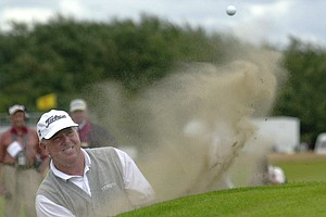 Mark O'Meara of the United States plays from a bunker on the 11th hole during the third round of the British Open Golf Championship at Royal Lytham and St. Anne's golf course in England Saturday, July 21, 2001.