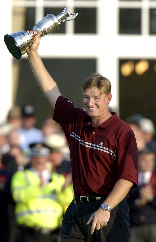 South Africa's Ernie Els holds aloft the trophy after winning the British Open Golf Championship at Muirfield golf course in Scotland Sunday, July 21, 2002. Els rebounded from one setback after another and outlasted Thomas Levet of France to win the British Open in a four-man playoff that produced the first sudden-death finish in the 142-history of the tournament.