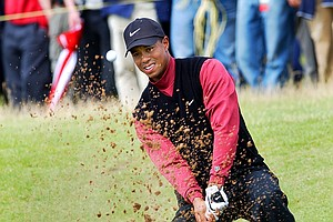 Tiger Woods of the United States plays from a bunker during the final round of the British Open Golf Championship at Muirfield golf course in Scotland Sunday July 21, 2002. Woods posted a 6-under par 65 to finish the tournament on level par.