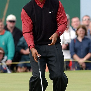 Tiger Woods of the United States reacts after missing a putt on the 13th green during the final round of the British Open Golf Championship at Muirfield golf course in Scotland Sunday July 21, 2002. Woods posted a 6-under par 65 to finish the tournament on level par.