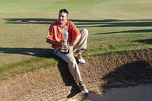 Ben Curtis, of the United States, celebrates with the trophy after winning the British Open golf championship at Royal St. George's golf course in Sandwich, England, Sunday, July 20, 2003. Curtis won the event after shooting a final round 69 for a 1-under par four round total of 283.