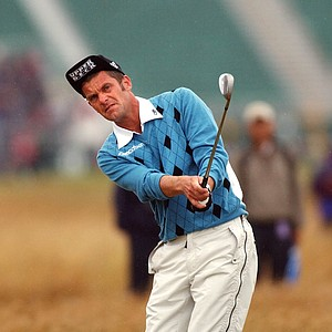Sweden's Jesper Parnevik chips to the 1st green during the first round of the British Open golf championship at Royal St. George's golf course in Sandwich, England, Thursday July 17, 2003.