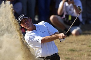 Denmark's Thomas Bjorn attempts unsuccessfully for the first time to get out of a bunker on the 16th hole during the final round of the British Open golf championship at Royal St. George's golf course in Sandwich, England, Sunday, July 20, 2003. Bjorn took three shots in the bunker and made a double bogey on the hole.